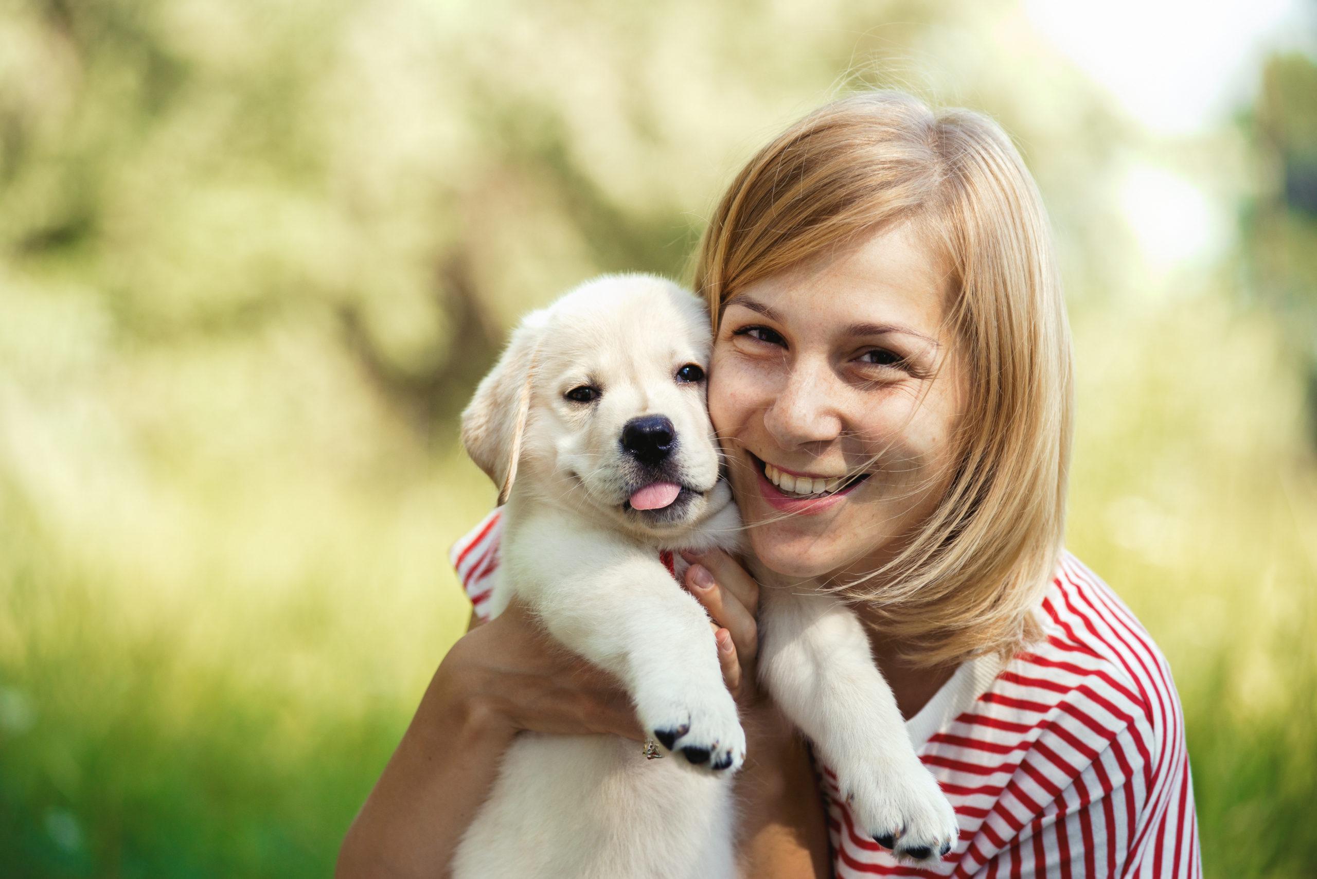 Girl with labrador puppy